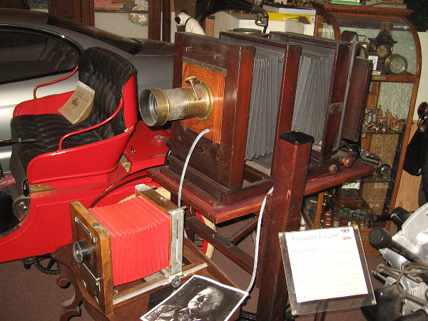 A couple of early cameras among a vast collection of antiques and memorabilia filling the J. A. Cooley Museum.