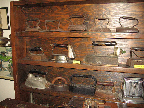 Shelves filled with old irons.