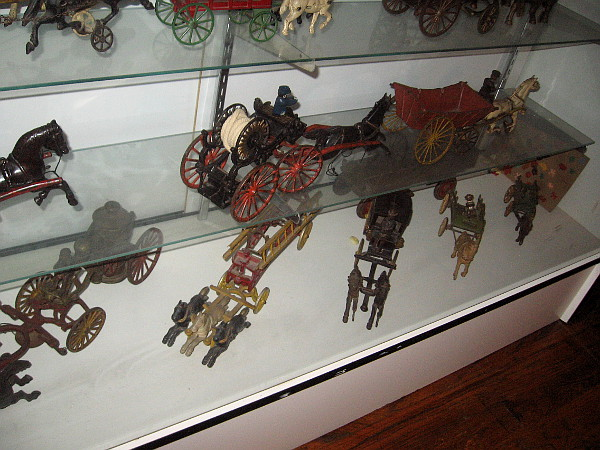 Antique cast iron horse drawn toy fire engines.