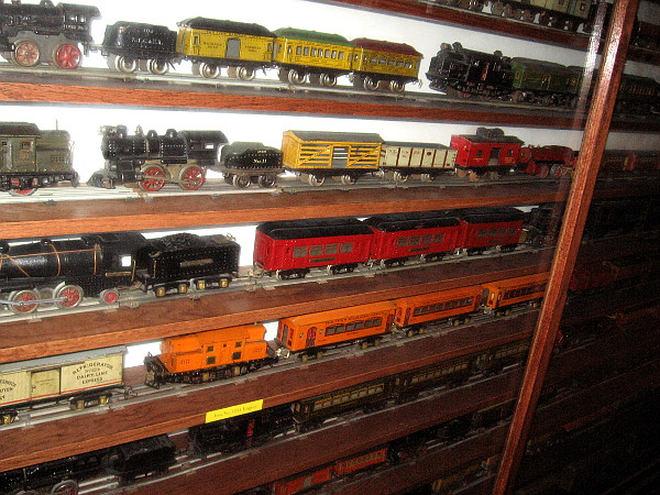 Shelves and shelves of Standard Gauge toy train locomotives and cars from 1900 to the 1940's.