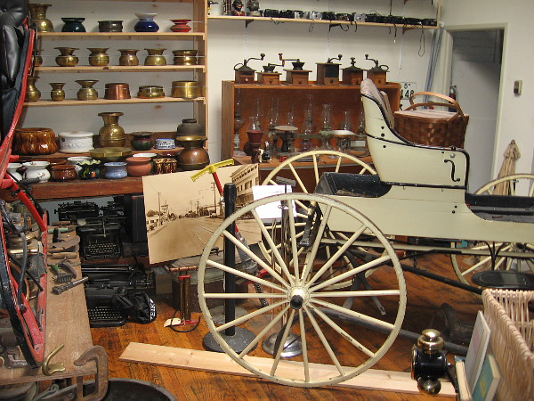 One corner of the J. A. Cooley Museum contains shelves of spittoons, coffee grinders, old lanterns and more!