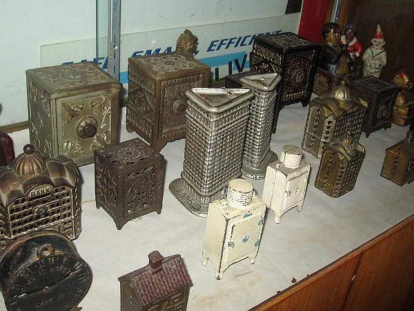 I believe these are cast iron coin banks.