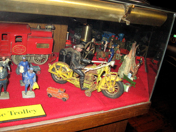 All sorts of cool cast iron figures and toys, including an awesome motorcycle!