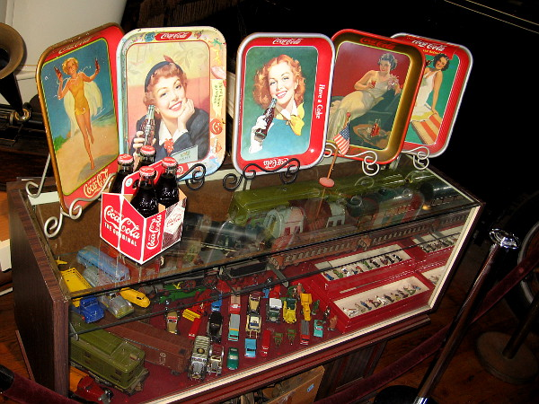 Some classic Coca Cola trays and even more antique collectibles.