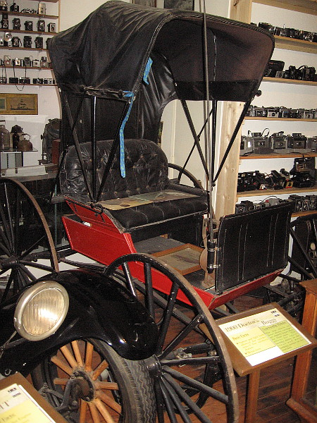 1900 Doctor's Buggy. The narrow, light body allowed for quick travel during medical emergencies. The tires are metal.