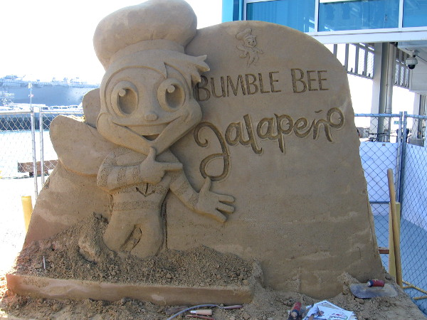 Bumble Bee Jalapeno is advertised with a fun sand sculpture in front of the Port Pavilion.