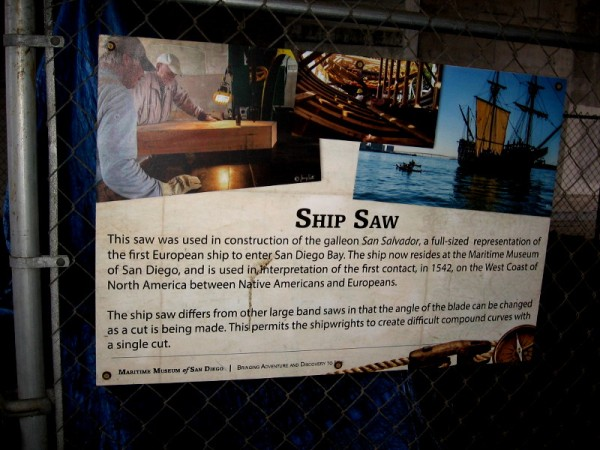 A sign that describes a ship saw, recalling how this one was used to help build the Spanish galleon replica San Salvador.