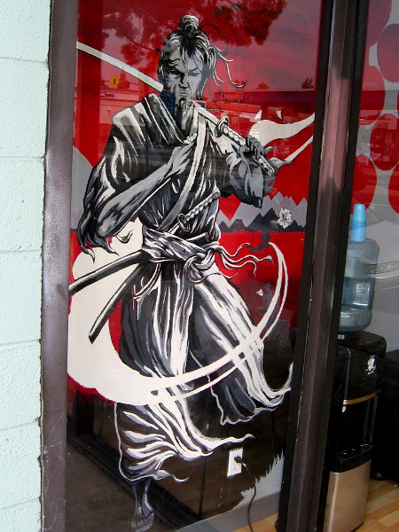 Cool art in a window of Allegory Tattoo.