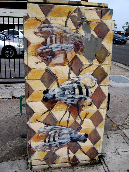 Bees in a hive on this eye-catching electrical box.