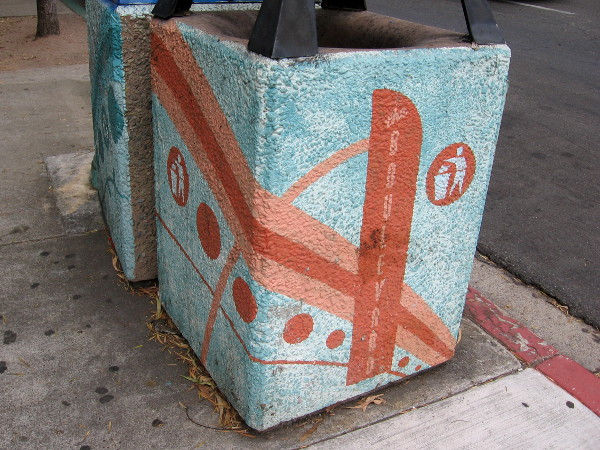 Trashcans on the sidewalk feature the Boulevard graphics.