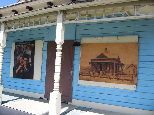 On the front of the house is a classic Top Gun poster and a vintage photo of the house as it once looked, over a century ago.