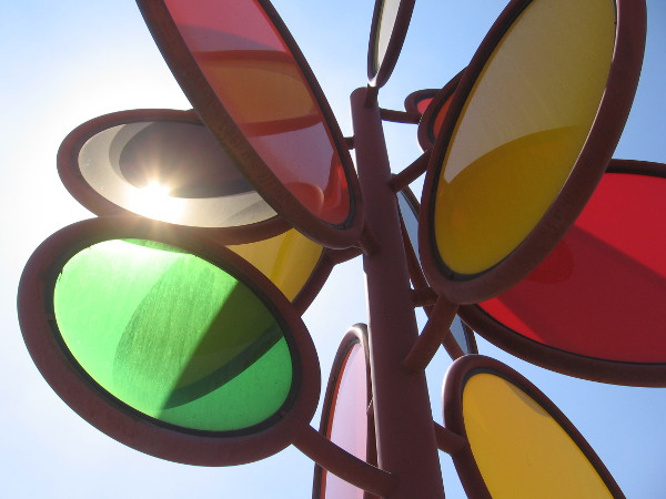 "Sunlight shines through the ""sunset"" sculpture. I see the green flash!"