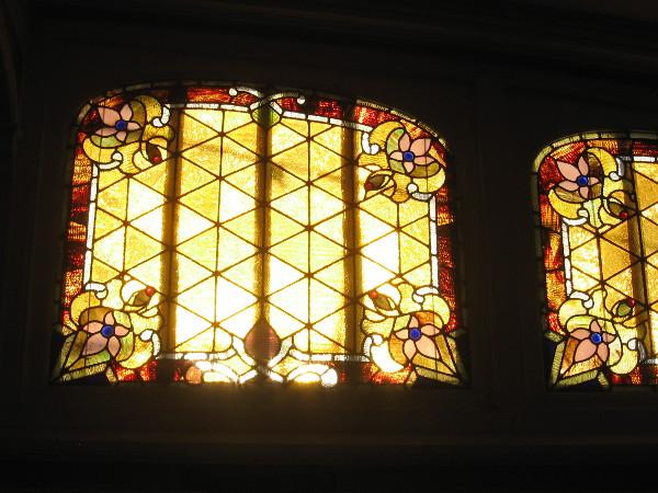 Sunlight brightens west-facing art glass windows on the passenger deck of the steam ferry Berkeley.