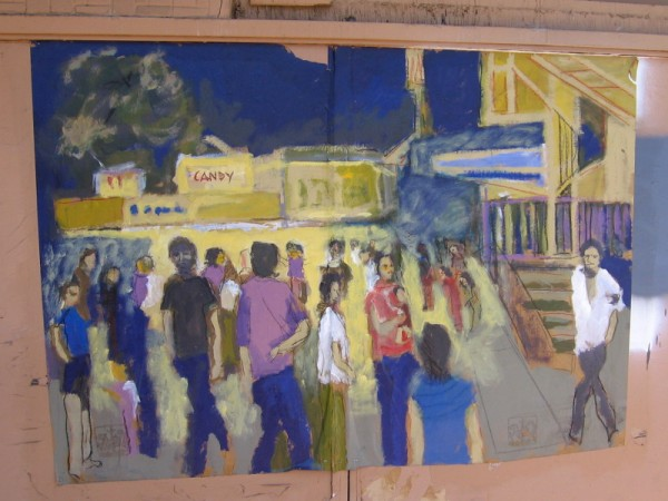 Street art on the front of The Vogue Theater in Chula Vista depicts a night out at the movies.