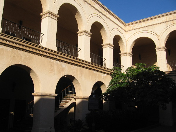 San Diego sunshine highlights arches at the Casa del Prado.