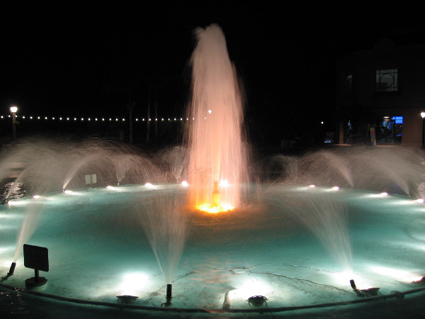The Bea Evenson Fountain lit at night.