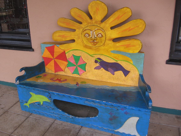 A cheerful sun, beach and ocean bench at Liberty Station in Point Loma.