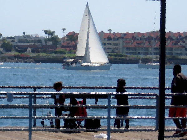 Fishing from a pier on sunlit San Diego Bay.