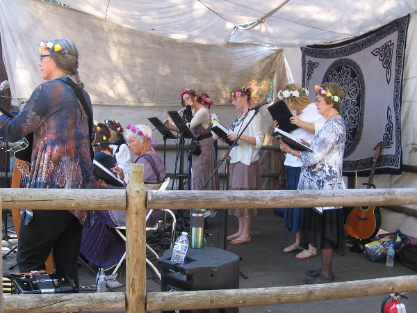 The singing group Damekor performs on the Loke Stage during the Viking Festival.