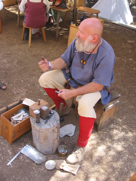 A metalsmith was at work in the festival's Northern Territory.