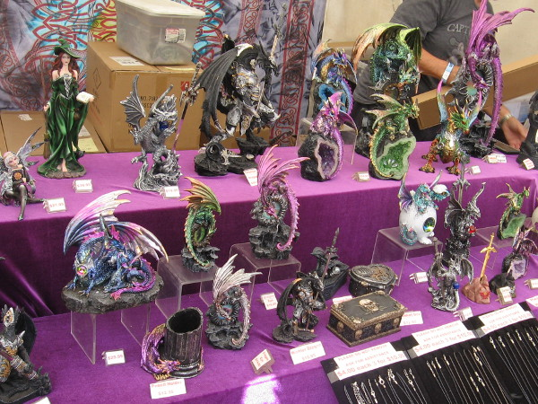 One vendor had all sorts of fantastic figurines on display. I see a couple of dragons perched on geodes.