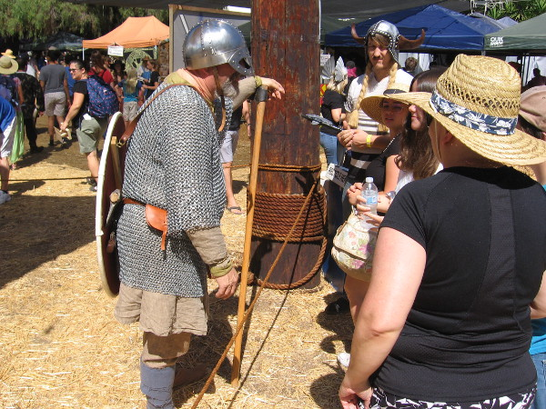A Viking combat demonstration had just ended, and some festival visitors were talking to one of the participants.