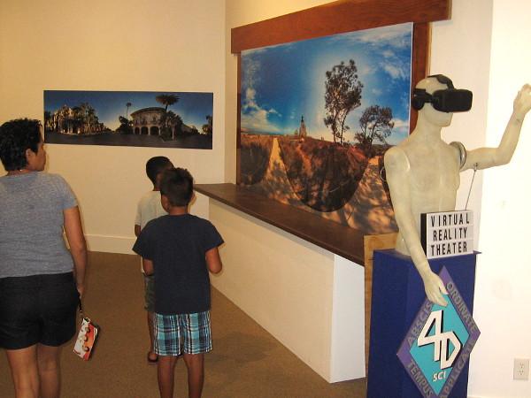 Visitors to the San Diego History Center in Balboa Park prepare to enjoy a short virtual reality tour around San Diego.