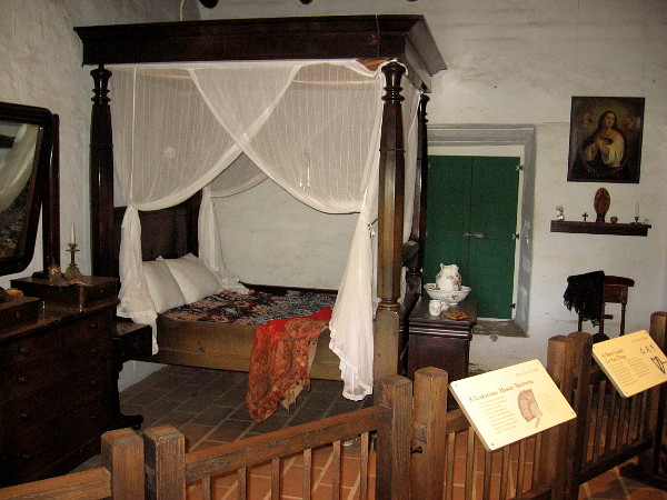 A bedroom inside La Casa de Estudillo contains a wealth of comfort, unusual in early San Diego, which was located far away from developed centers of commerce.