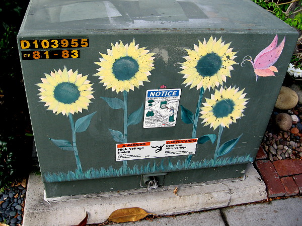 Painted sunflowers grow upon a transformer box in Coronado.