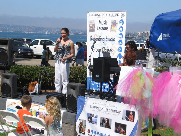 Young lady sings during a cool event on San Diego's Embarcadero--the first ever Kidpreneur Expo!