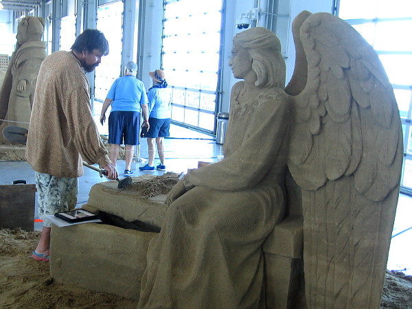 He Left From Here, an angelic sand sculpture by World Master Dmitry Klimenko from St. Petersburg, Russia.