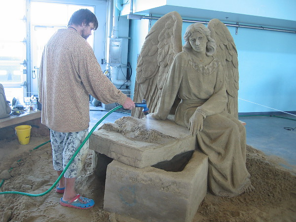 Dmitry Klimenko puts the finishing touches on another of his breathtaking works of sand art.