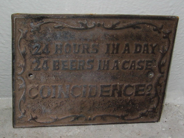 Sign in a window of The Bell Marker in downtown San Diego: 24 Hours In a Day. 24 Beers In a Case. Coincidence?