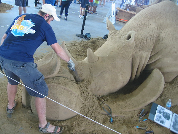 Brian Turnbough finishes a tribute to the endangered rhinoceros.