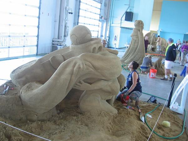 At Last, Atlas' Last Atlas!, a humorous sand sculpture by World Master Morgan Rudluff from Santa Cruz, California.