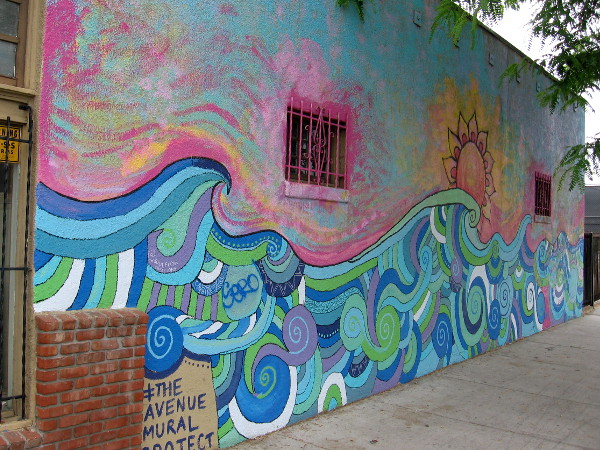 The first mural painted by The Avenue Mural Project in City Heights contains joyful swirls of many colors! Endless Summer was designed by artist Erin Bowman.