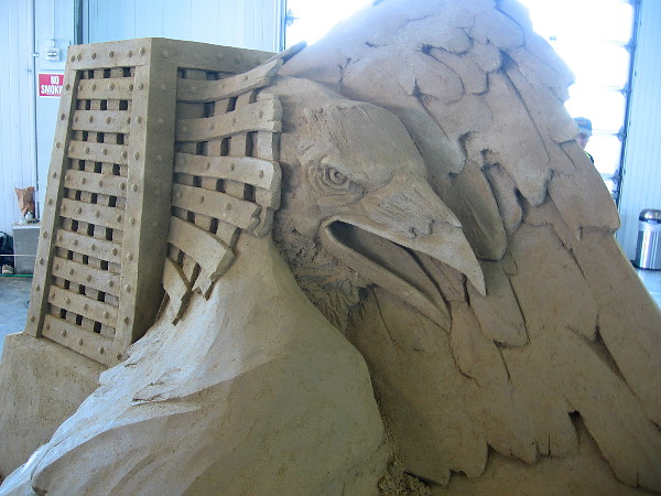 An eagle is liberated from a cell-like cage. Dynamic sand art with great emotional impact.