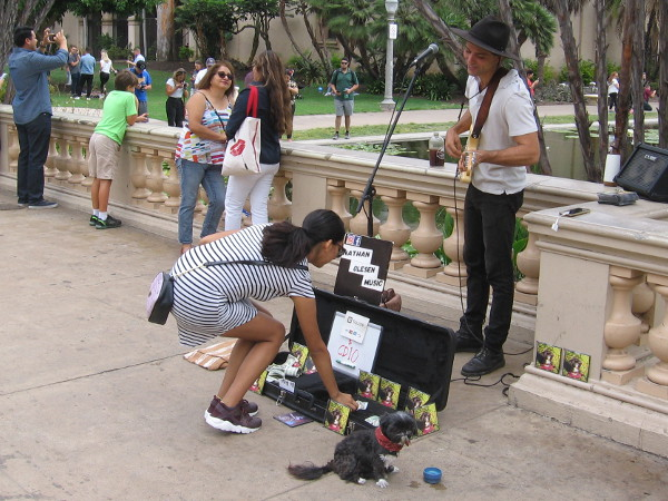 A street musician smiles on a sunny Labor Day in Balboa Park.