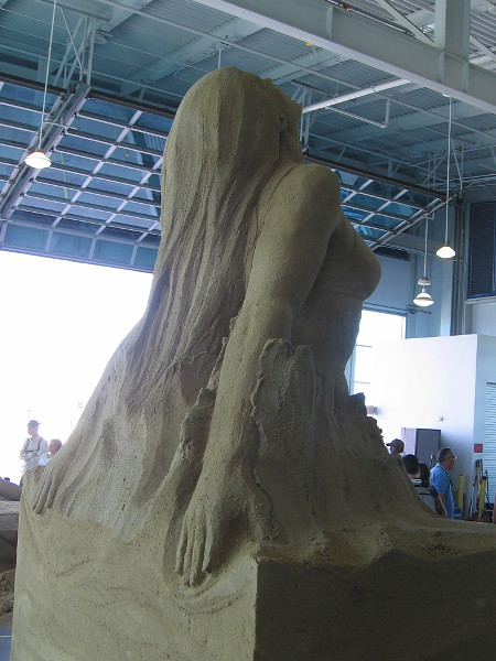 Flowing beauty magically rises from a block of sand.