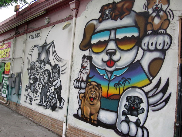 Another local store has happy, inviting murals painted on a side of their building.
