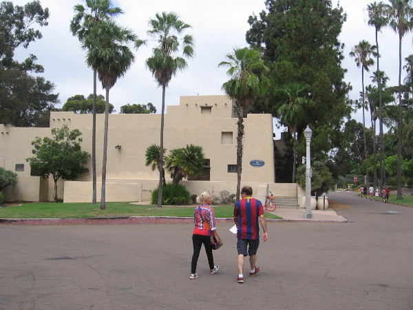 Walking through Pan American Plaza between the San Diego Automotive Museum and nearby Recital Hall.