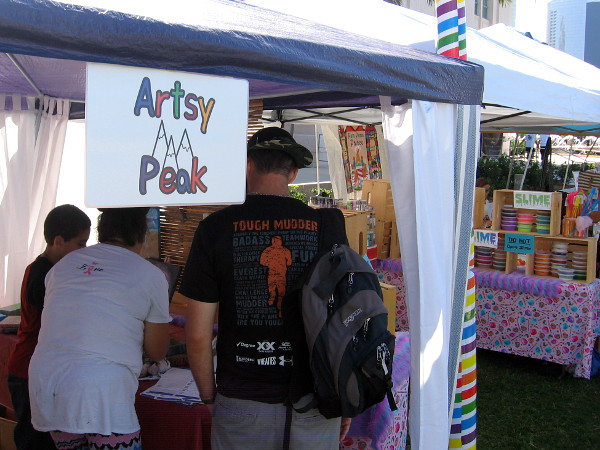 A young artist was showing his great artwork at his booth called Artsy Peak.