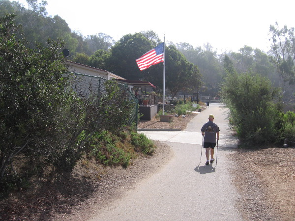 A hiker approaches the Batiquitos Lagoon Nature Center from the Gabbiano Lane trailhead.