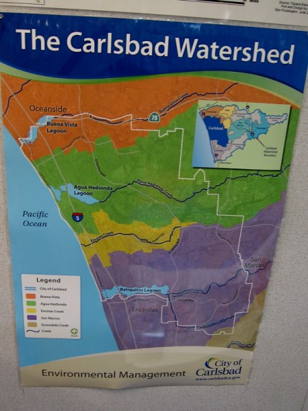 A poster shows Carlsbad's watershed, including the area where fresh water (including San Marcos Creek and Encinitas Creek) flows into Batiquitos Lagoon.