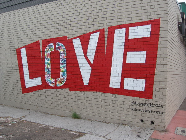 Los Angeles muralist Ruben Rojas, co-founder of Beautify Earth, painted LOVE on the side of 7-Eleven in City Heights.