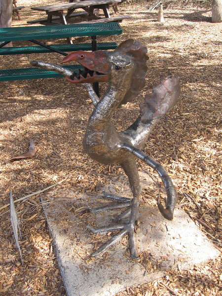 Next to some picnic benches by the Nature Center, you'll find a very strange creature lurking. It's The Creature From Batiquitos Lagoon, by artist Paul Weber, 2003.