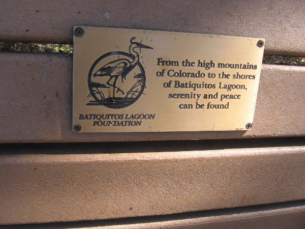 Plaque on one bench by the trail. From the high mountains of Colorado to the shores of Batiquitos Lagoon, serenity and peace can be found.