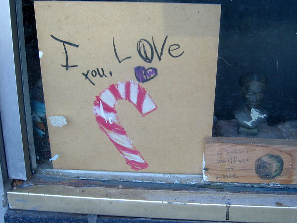 Over three months to Christmas, and I already see a candy cane in one window!