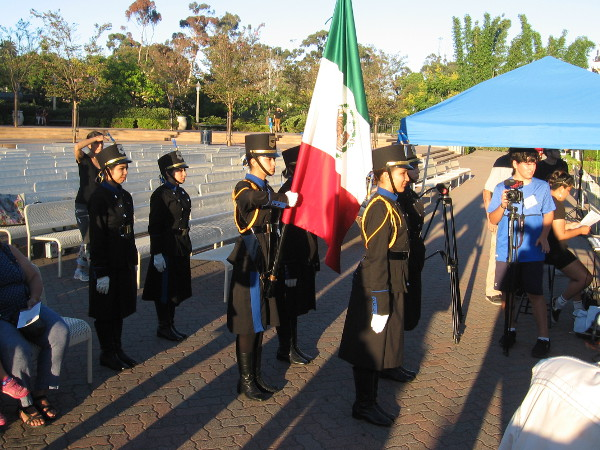 During the program, a color guard advanced the Mexican flag to the stage, and the traditional Grito Mexicano was shouted. Viva México!