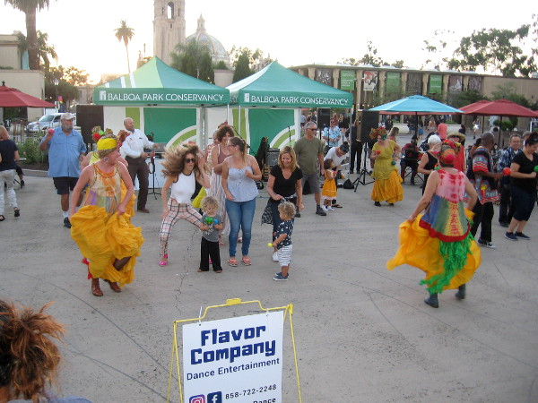Meanwhile, in the nearby Plaza de Panama, the Flavor Company dance group had people dancing the Conga for Balboa Park's Food Truck Friday.